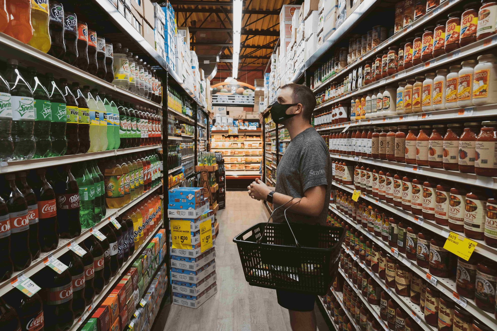 A man looking at beverages on a grocery store