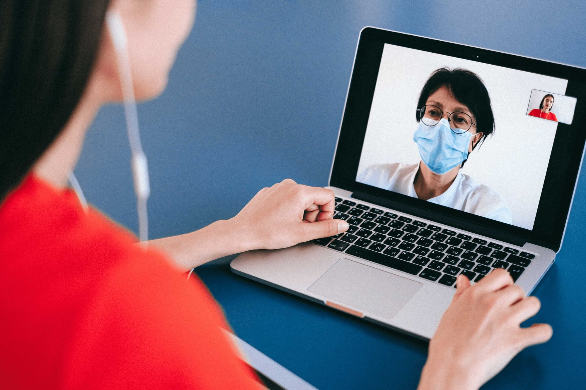 A patient consulting with her doctor through a video conference meeting