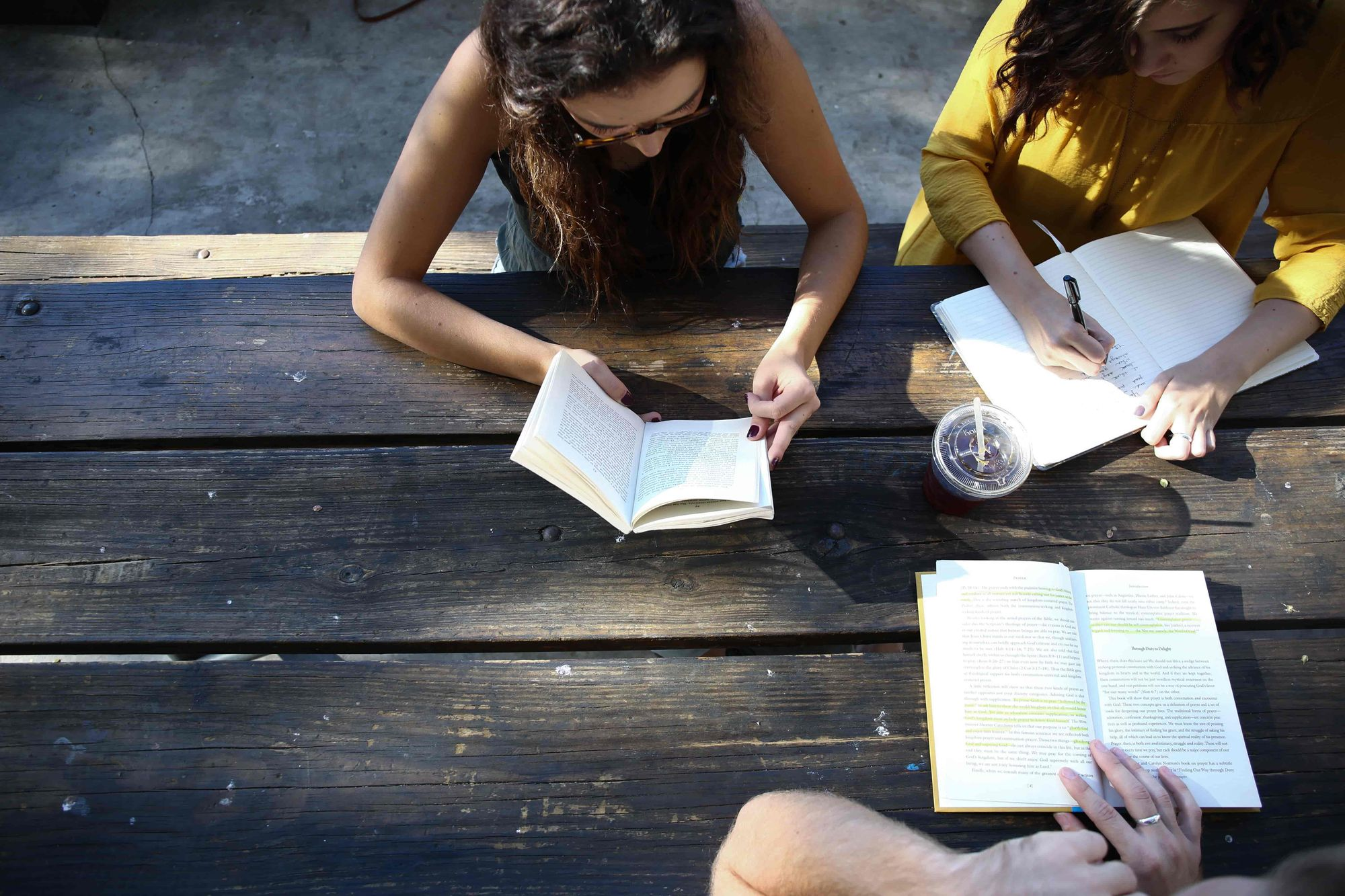 Three female students learning in a group.